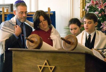 A family celebrates the bar mitzvah of their son. A Bar Mitzvah is an important step on the journey to manhood, how families reinforce values, religion and family, family values, passage to manhood,