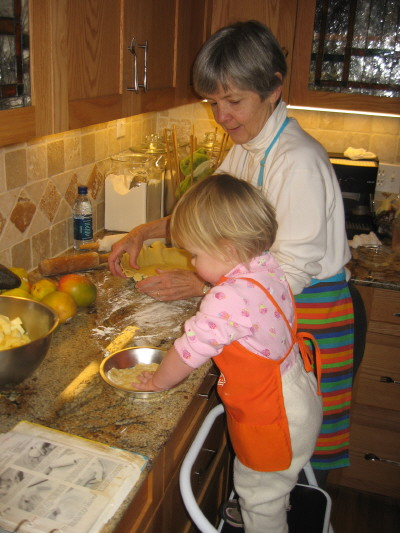 My sister Kathy cooking with one of her five grandchildren.