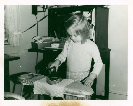 Little kids ADORE chores. This is me at age 4 or 5 ironing. I couldn't wait until I got a pillowcase or handkerchief to iron. Chore make children feel good about themselves. Chores nurture self esteem. Chores teach responsibility.