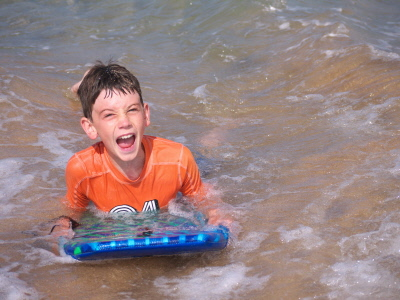 family Vacation is a wonderful time to spend together. It brings out how you are parenting. Have you taken time to set respectful boundaries? Do you know how to communicate, motivate and manage them? This boy is having fun on a boogie board. The family is used to doing things together. Family Vacations can be stressful if the family is poorly managed