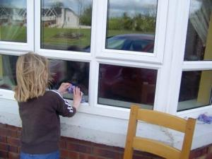 This young girl is showing the value of family chores. She is washing windows. This task gives her connection to family, self esteem and self-discpline, all of which cannot be bought at K-Mart or Wal-Mart. Yes, it takes more time for mom to involve the kids. Yes, the kids won't do as good as a job. Yes, it requires family meetings and encouragement. it's worth the investment in your family.